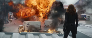 Black Widow looks at an explosion